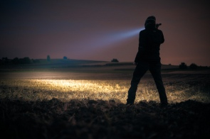 flashlight-torch-shining-across-field
