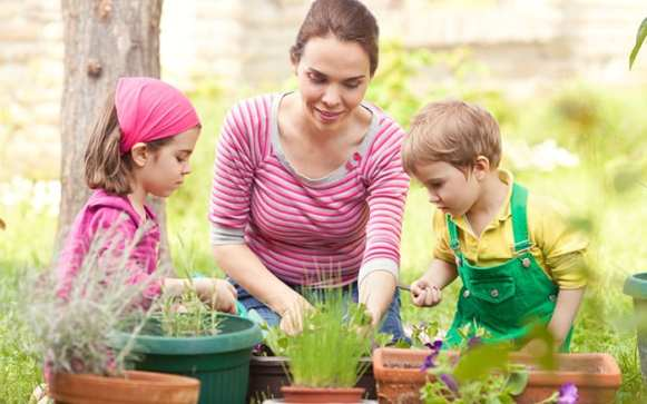 family-planting-containers-in-the-garden